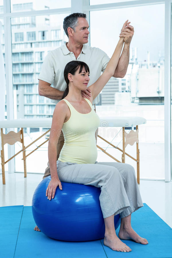 Physiotherapist Giving Physiotherapy To Pregnant Woman ...
