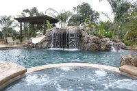 A Pool With A Waterfall In A Luxury Backyard Stock Photo ...