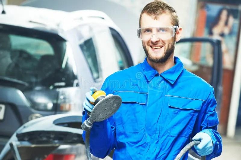 Auto Mechanic At Car Suspension Repair Work Stock Photo
