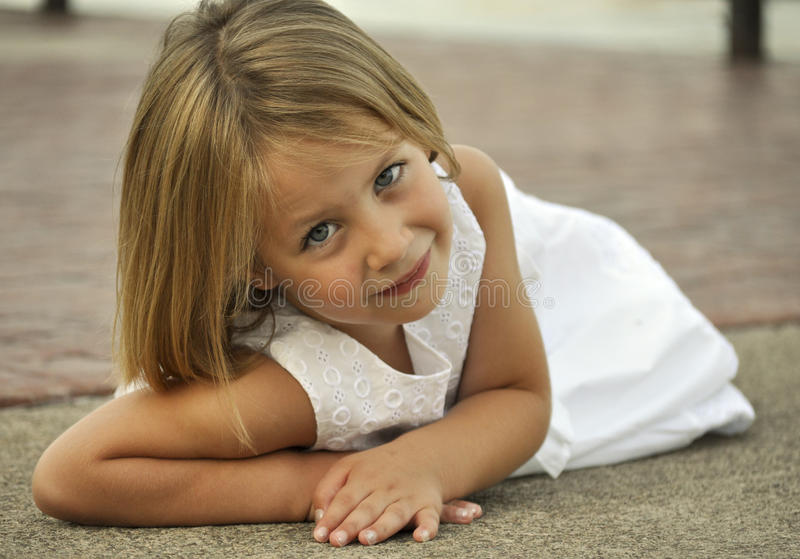 Pretty Little Girl Laying Down Outdoors Stock Image ...