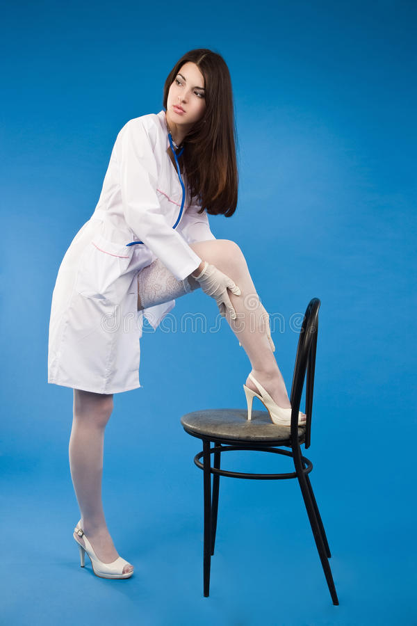 A Pretty Young Nurse Straightens Stockings Royalty Free