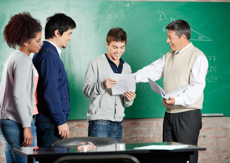 Professor Giving Exam Result To Student At Stock Image