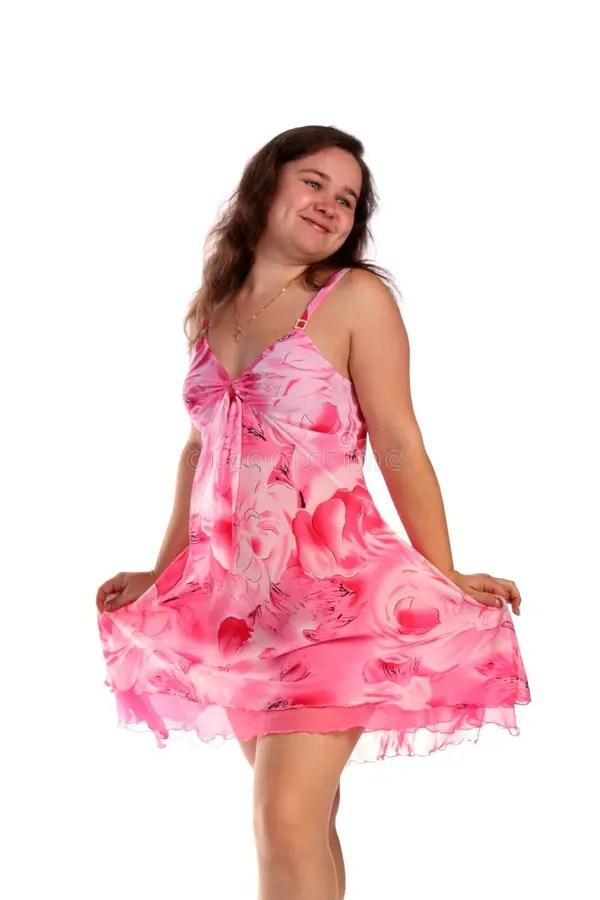 Ragazza Riccia Nella Posa Rosa Del Vestito Immagine Stock