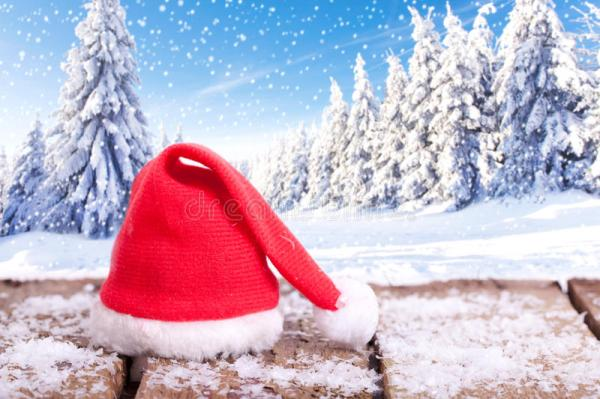 red santa claus hat in winter landscape