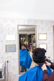 reflection of stylist and client