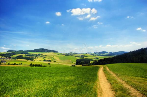 road in hilly landscape stock