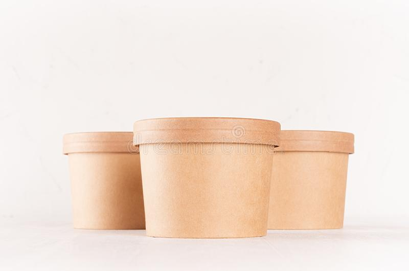 500ml ice cream paper tubs mockup to showcase your branding packaging design in a photorealistic style. Set Of Three Blank Kraft Paper Bowls With Caps For Fast Food On White Wood Table Closeup Food Mockup For Branding Identity Stock Image Image Of Cafe Container 138092627