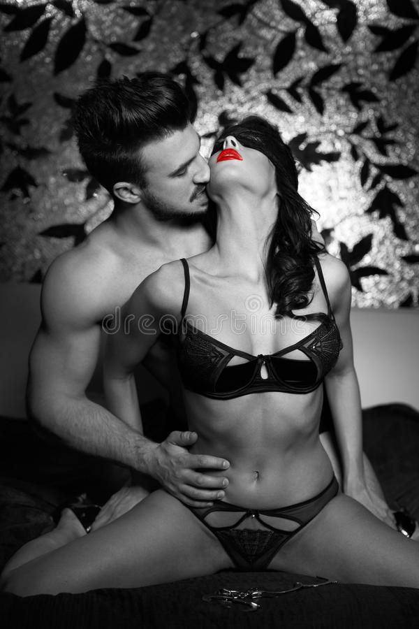 Couple Kissing On Bed At Night Black And White Stock Image