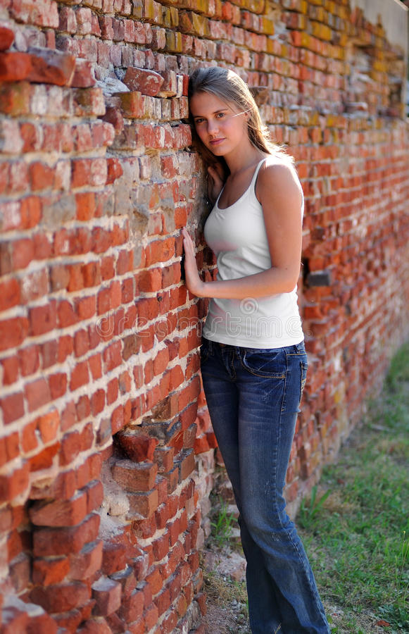 Leaning Against Brick Wall