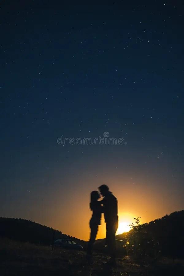 couple under stars stock