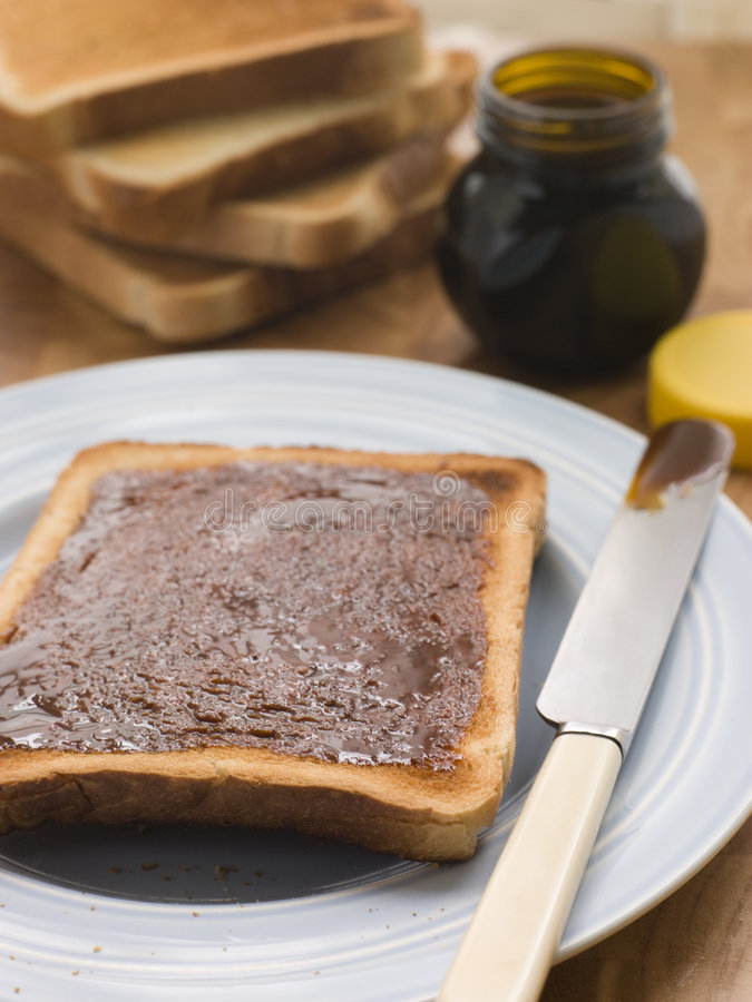Slices Of Toast With Yeast Extract Spread Stock Photo ...