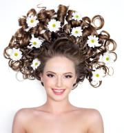 smiling woman with flowers in hair