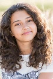 teen girl with curly dark hair