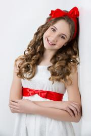 teen girl with red bow head