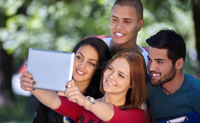 Teens Having Fun And Hanging Out Outside Stock Photo