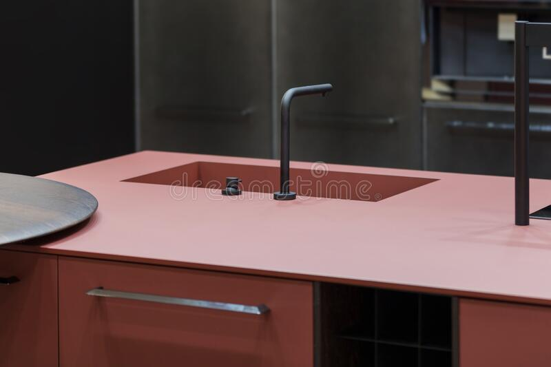 trendy kitchen of dark red color one