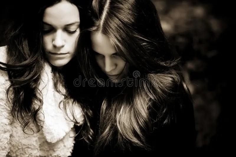 two sad girls stock