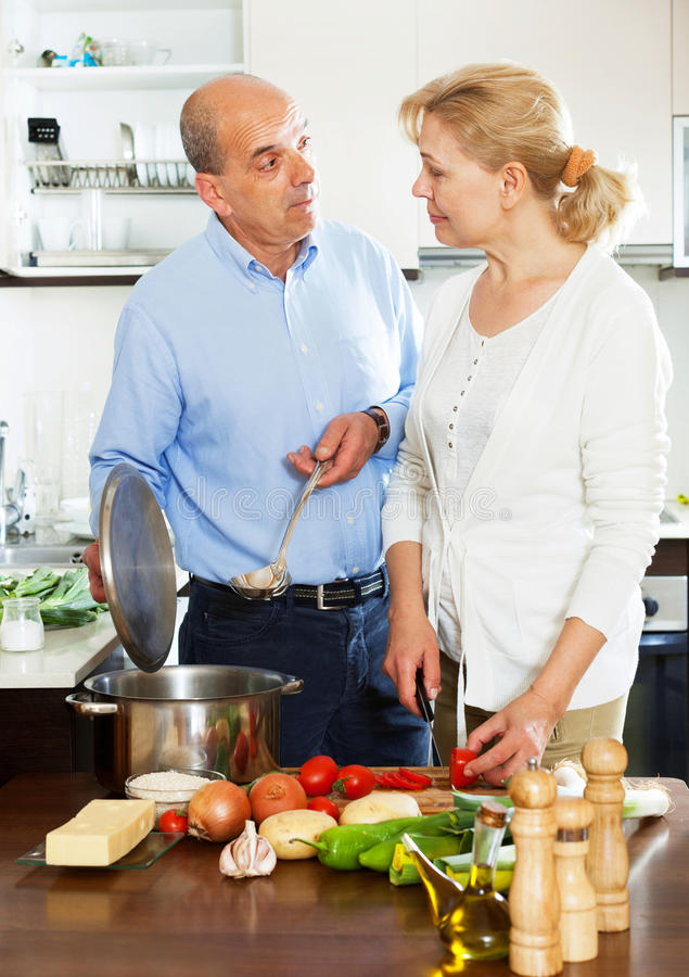 Two Senior People Cooking In The Kitchen Stock Image ...