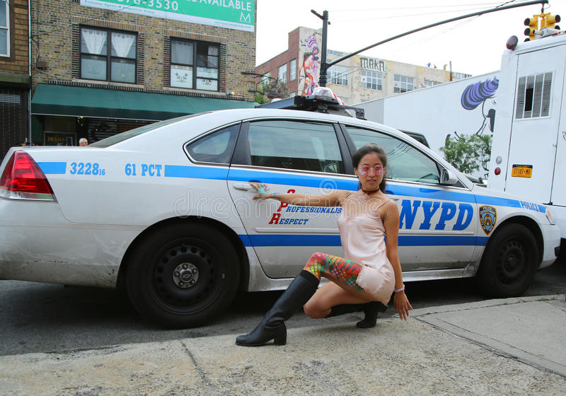 Unidentified Model Posing In The Front Of Nypd Police Car