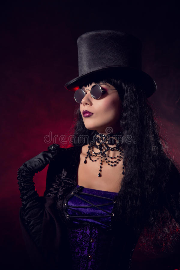 Vampire Gothic Girl In Tophat And Round Eyeglasses Stock