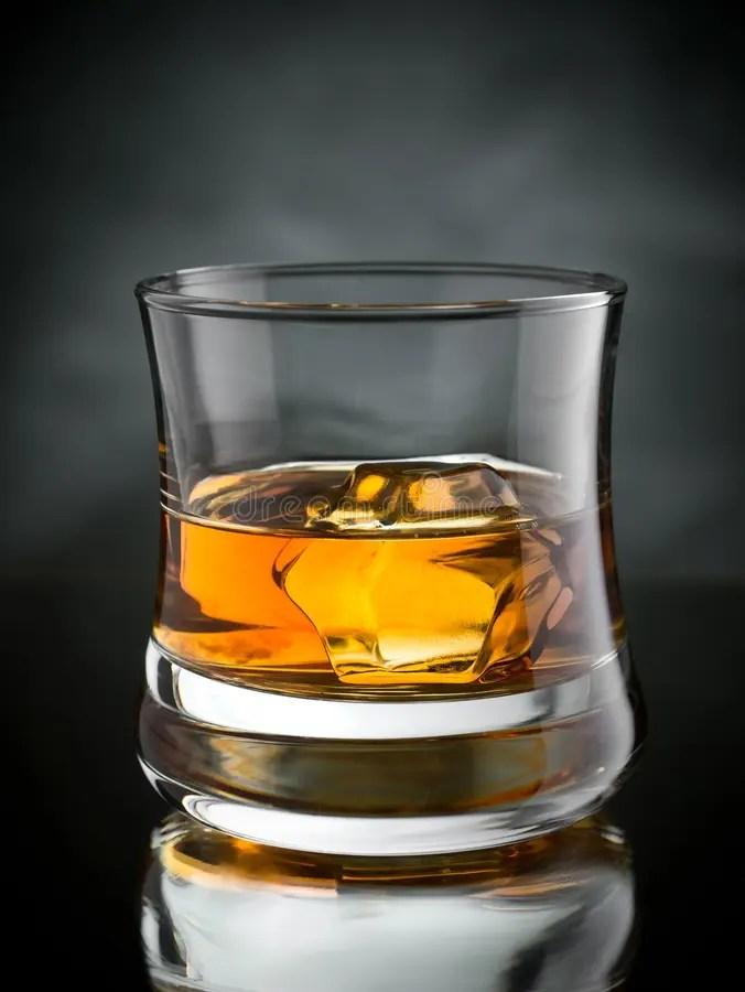 Whisky on the rocks stock image. Image of tumbler. bourbon - 35386435