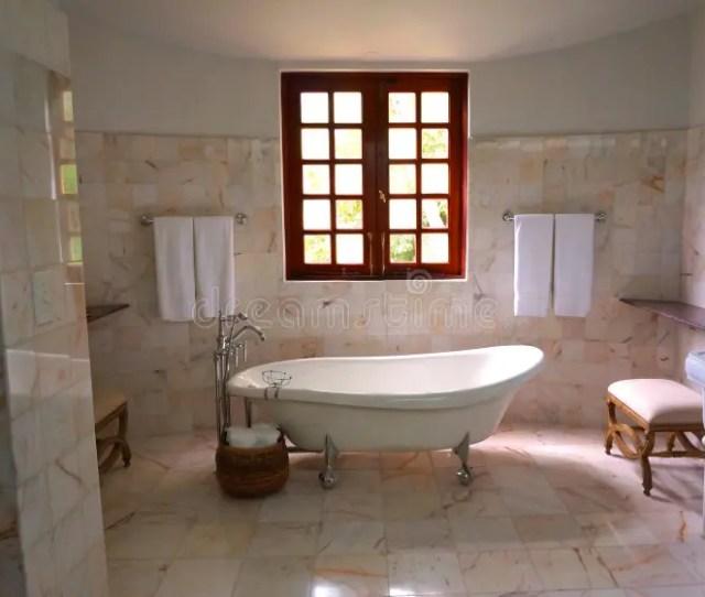 White Bathtub On White Tile Bathroom Near Brown Framed Clear Glwindow Public Domain Image