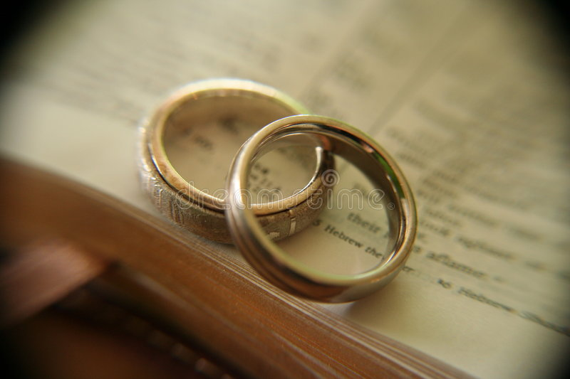 White Gold Wedding Rings On Bible Stock Images Image