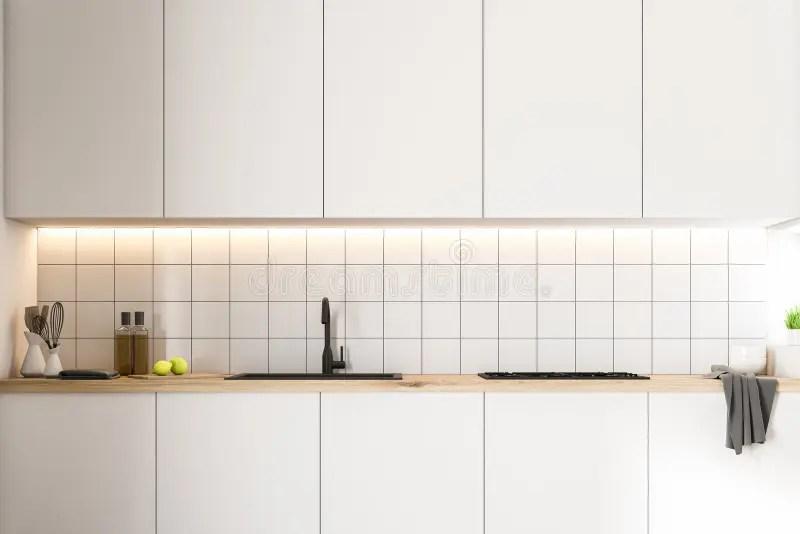white tiles kitchen white counters