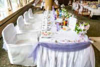 White Wedding Party Table With Fancy Chairs And A Lot Of ...