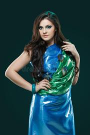 woman in brilliant blue-green dress