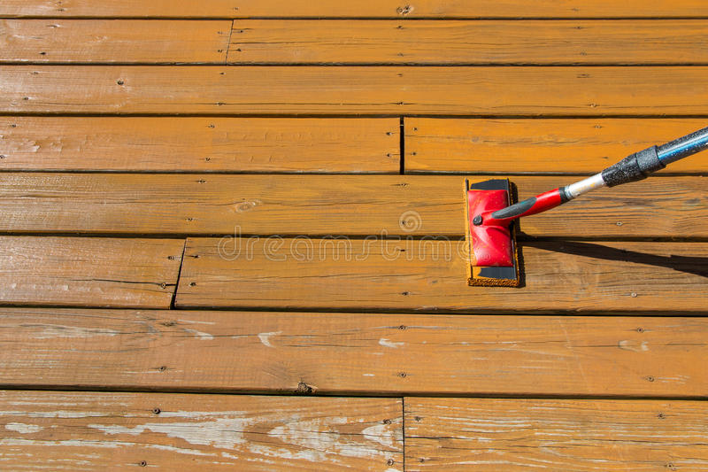 paint pad on wooden patio floor