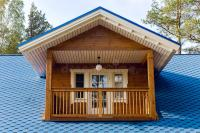Wooden Balcony In A Small House With Blue Roof Stock Image
