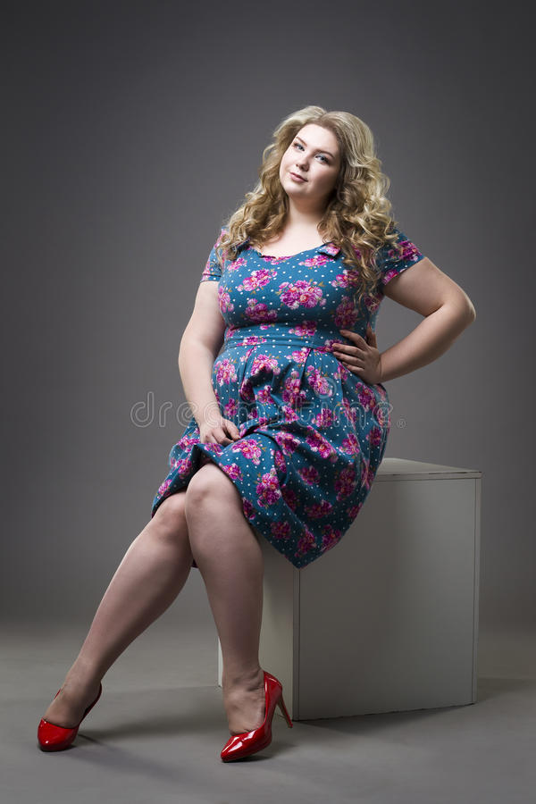 Young Beautiful Happy Blonde Plus Size Model In Dress And