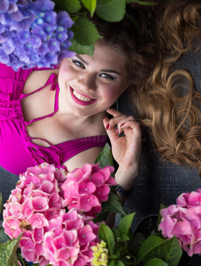 Young Beautiful Plus Size Model Lying In Flowers Xxl