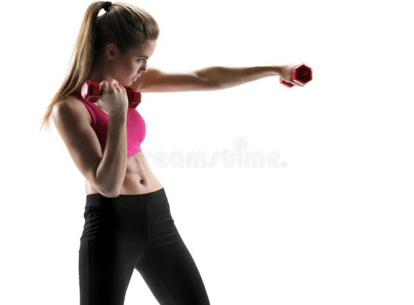 Young Woman Doing Boxing Exercise With A Dumbbells As A
