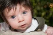 baby boy brown eyes nursing stock