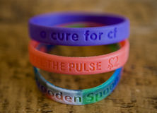 Charity wristbands Stock Images