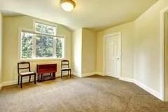 empty yellow walls carpet brown background windows