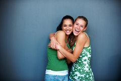 Friendship - Two girlfriends hugging eachother Stock Photos