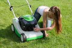 sexy woman lawn mower stock