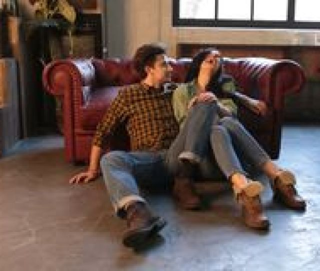 Happy Couple Joking Before Sex On A Couch In The Living Room At Home Stock Video