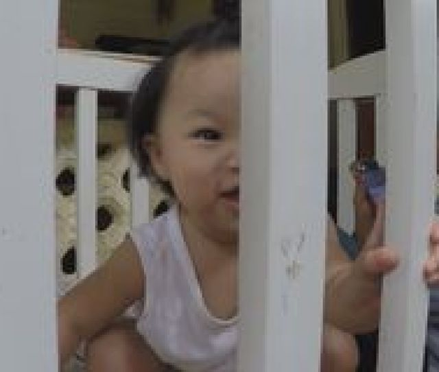Baby Girl Playing By Herself Creeping In Crib Stock Video Footage