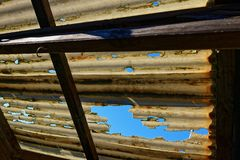 a damaged corrugated plastic roof that