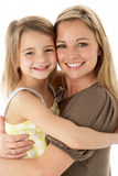 Studio Portrait Of Mother Hugging Young Daughter Royalty Free Stock Images