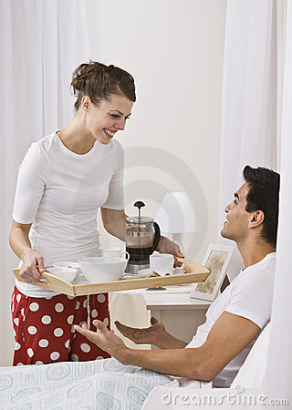 Attractive Woman Serving Breakfast In Bed Royalty Free