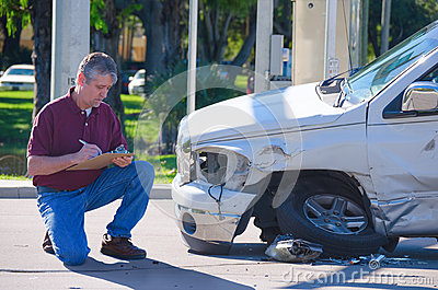Auto Insurance Adjuster Inspecting Accident Claim Stock Photo  Image 48208777