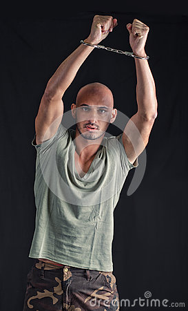Bald Young Man Handcuffed With Arm Up Royalty Free Stock