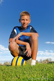 boy with sports ball stock