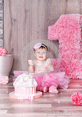 Cute Baby Girl Eating First Birthday Cake Stock Photo