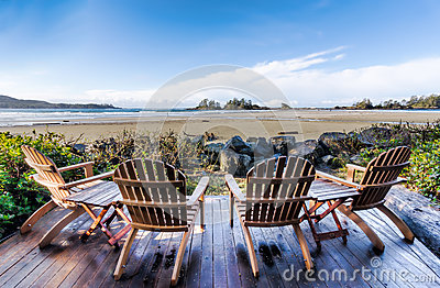 2 rocking chairs instrumental waiting for sale four on deck overlooking beach royalty free stock photos - image: 33426248